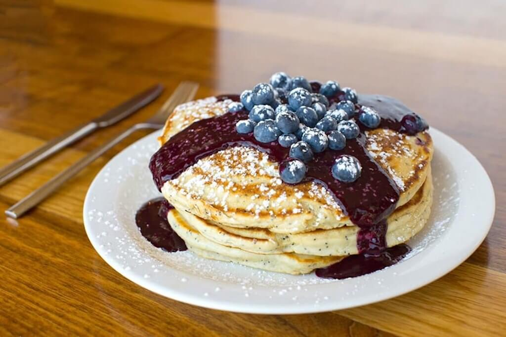 plate of pancakes with blueberry syrup and fresh blueberries Summerlin restaurants