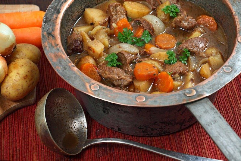 Irish stew in old copper pot