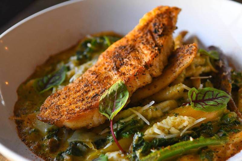 roasted fish dish with vegetables