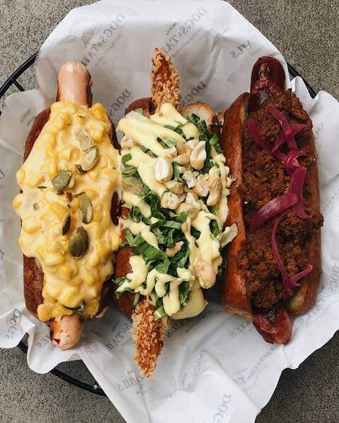 three gourmet hot dogs