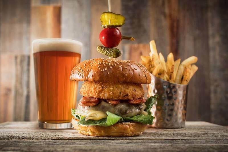 burger with fries and a beer