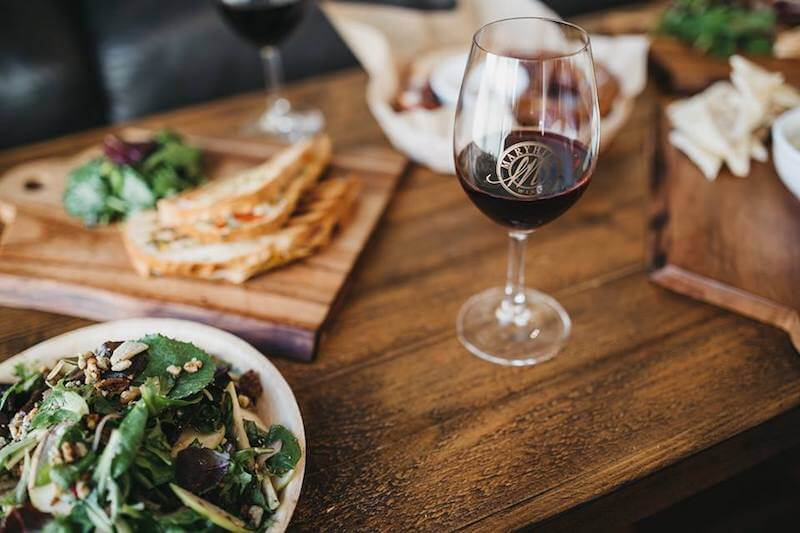salad sandwich and glass of red wine