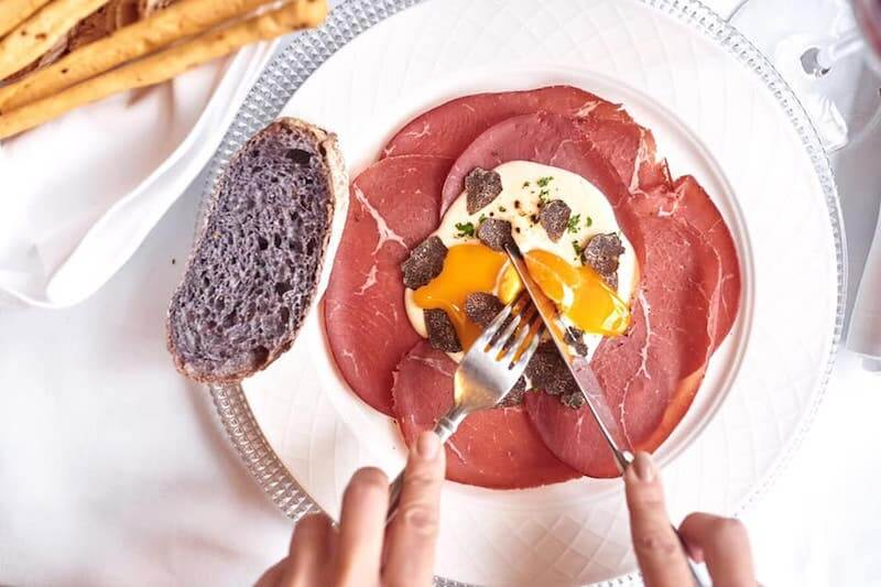 Italian cured meat with runny egg