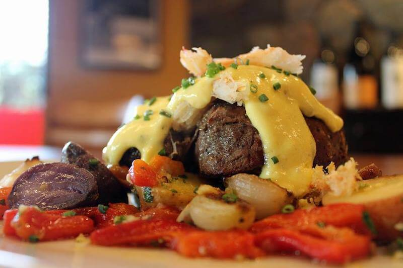 steak topped with seafood