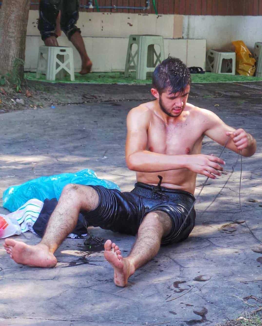 turkish oil wrestler lacing his kismet (uniform)