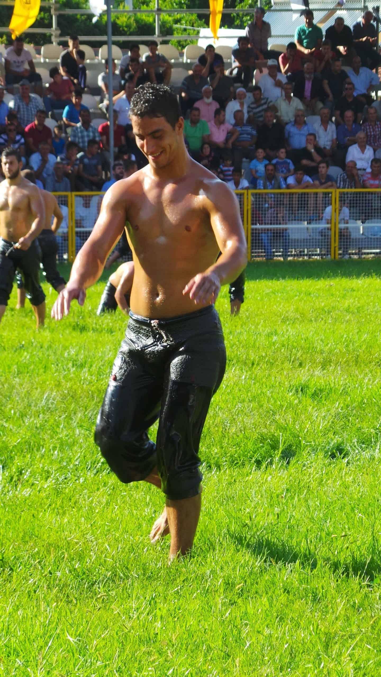 turkish oil wrestlers entering the field