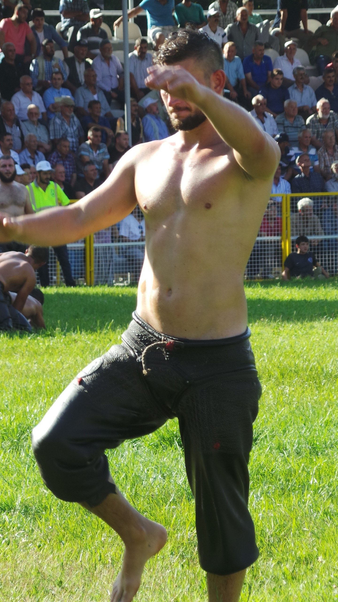 turkish oil wrestler entering the field for competition