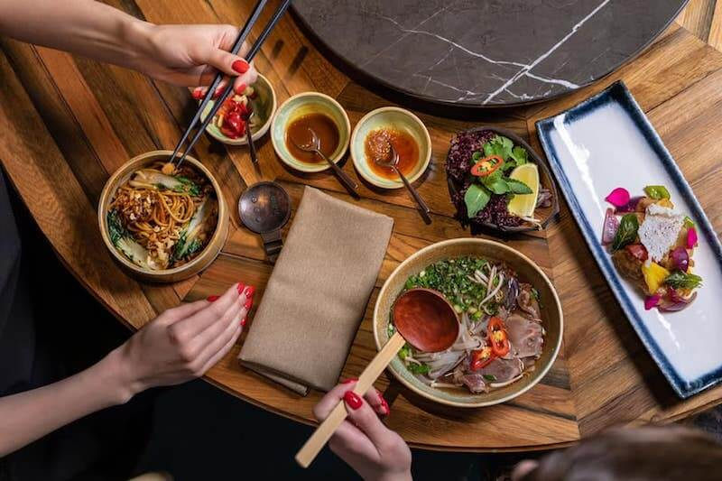 table full of Vietnamese food Kiev