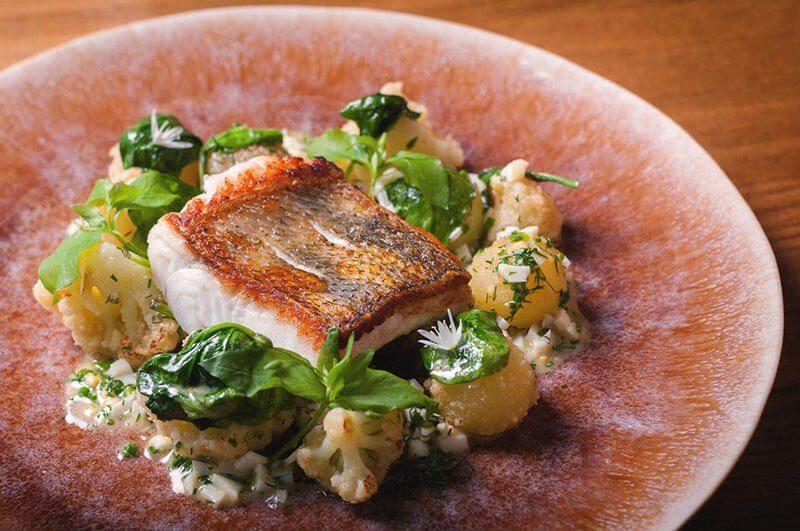 Must Try Poznan Restaurants - Where to Eat in Poznan, Poland - Oskoma - Fish Potatoes Cauliflower