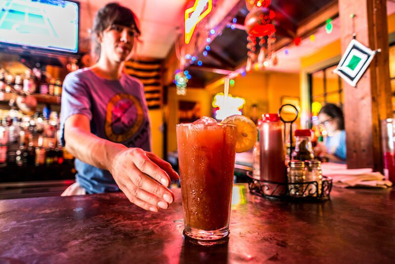 bartender serving a bloody mary