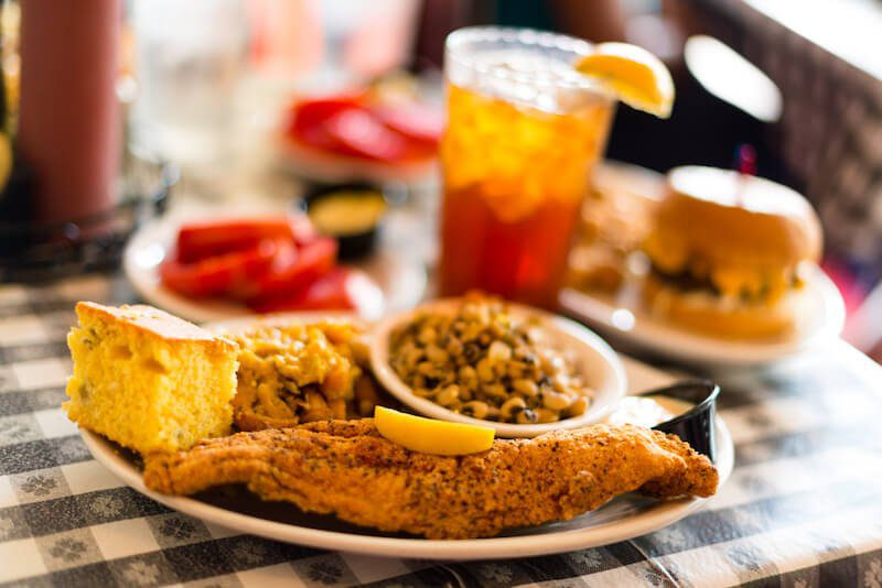 fried fish with cornbread and glass of tea