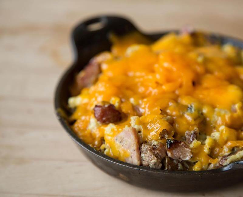 breakfast skillet topped with cheese