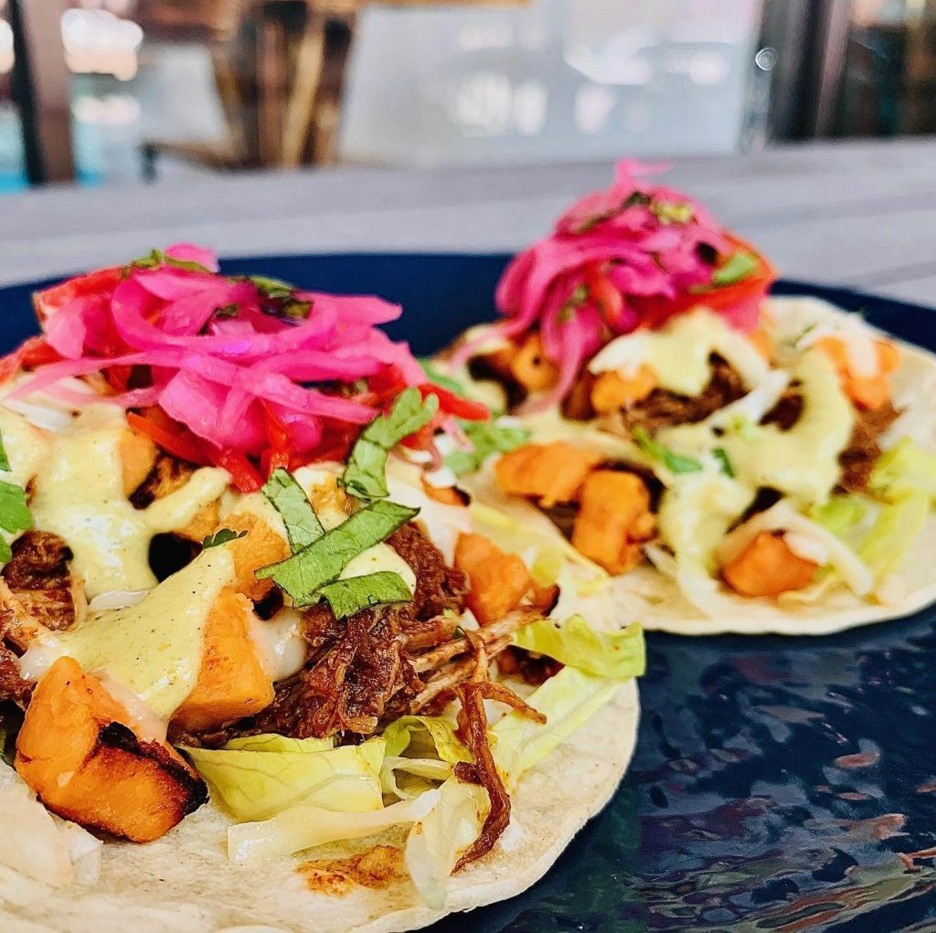 tacos topped with pickled onions