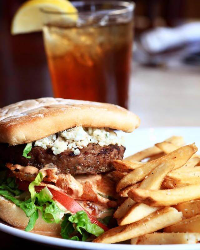 burger and fries with a glass of iced tea