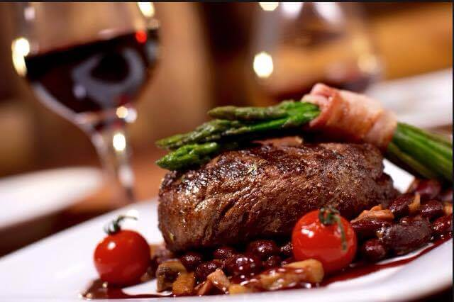 steak topped with asparagus