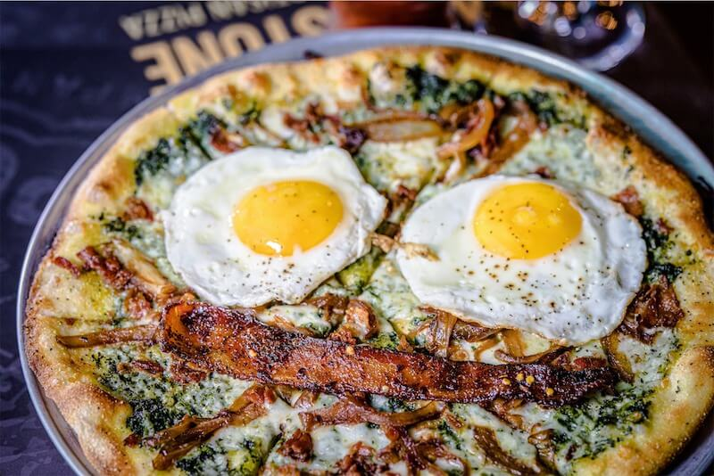 pizza with fried egg on top