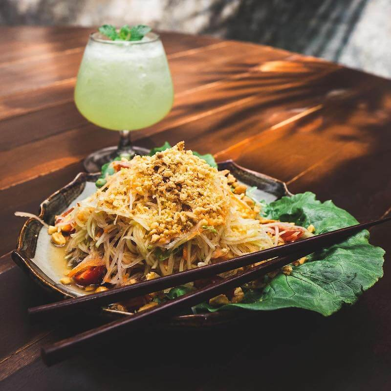pad thai and green colored cocktail