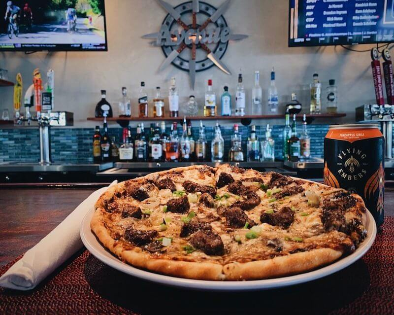 pizza in front of a bar