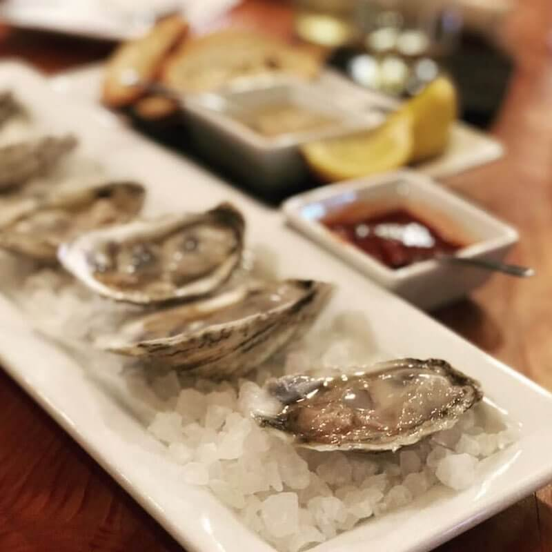 raw oysters on a plate of ice