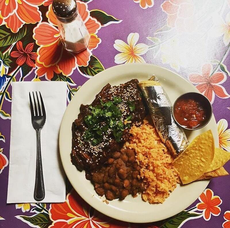 plate of mexican food with beans and rice
