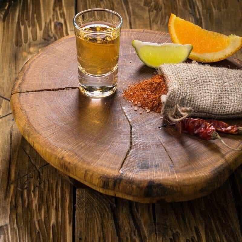 shot of mezcal with salt and orange slices