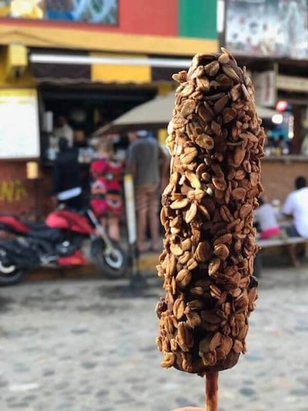 frozen chocolate covered banana rolled in oats