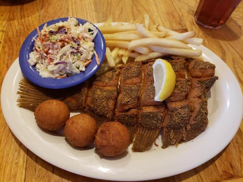 fried fish with coleslaw and french fries