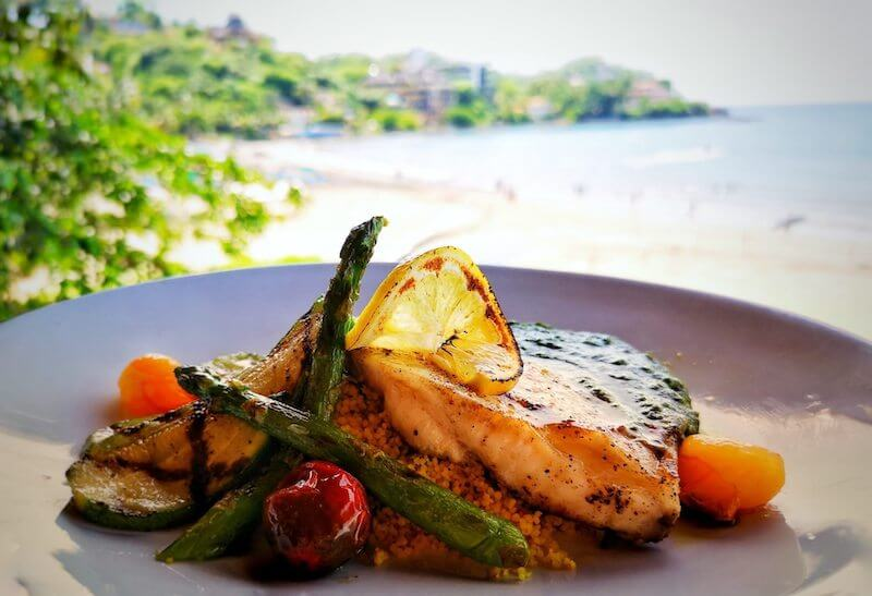 grilled fish and vegetables over couscous