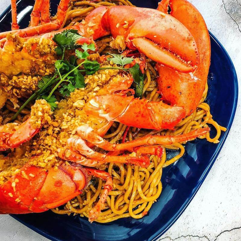 lobster over fried noodles