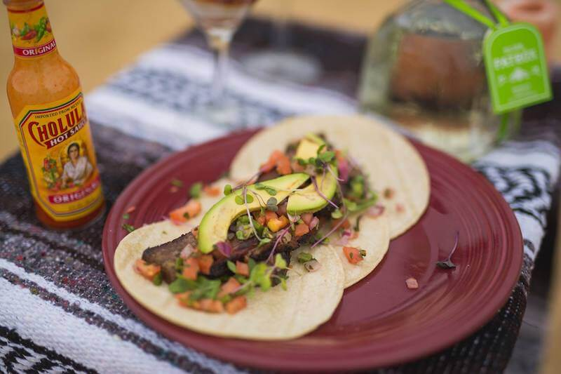 tacos with avocado and hot sauce