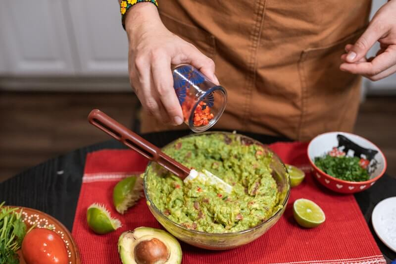 guacamole being prepared tableside