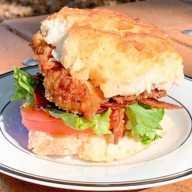 breakfast biscuit with fried chicken and bacon