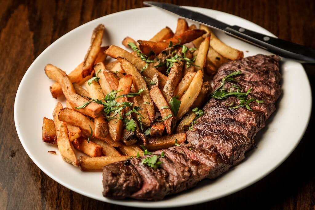 sliced steak with French Fries