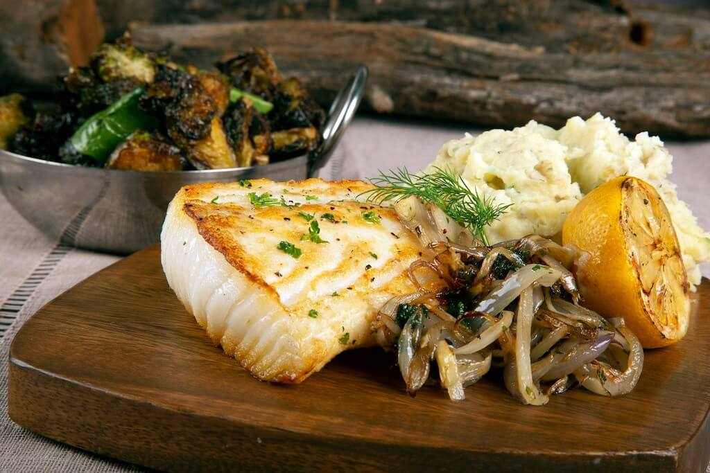 grilled fish with mashed potatoes and roasted vegetables