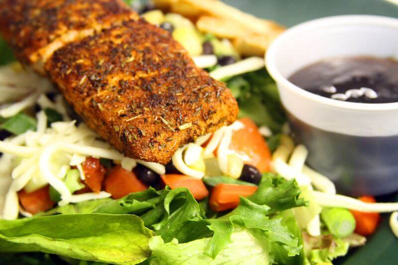 grilled salmon over salad