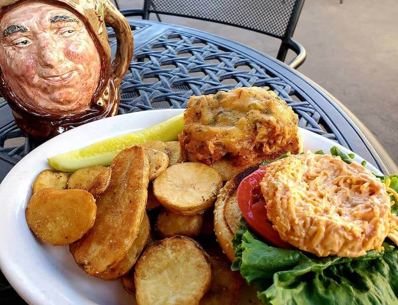 fried green tomato sandwich and roasted potato slices