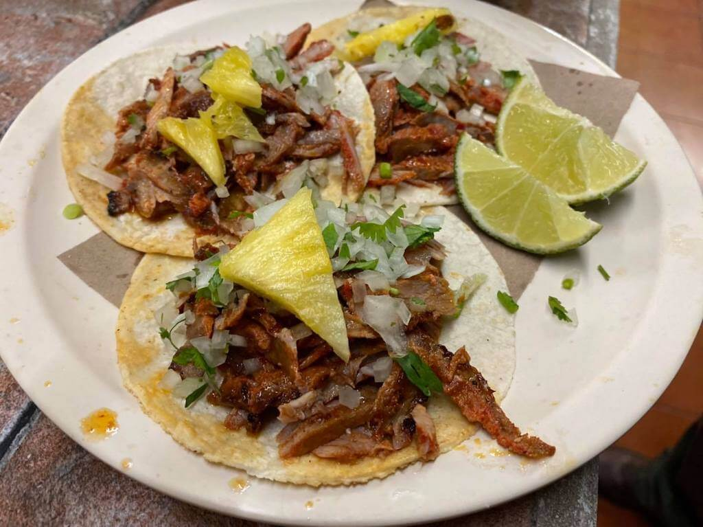 tacos al pastor with limes