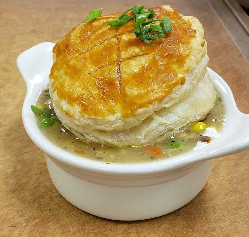 chicken pot pie topped with a biscuit