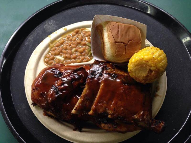 BBQ ribs, beans, corn and a roll