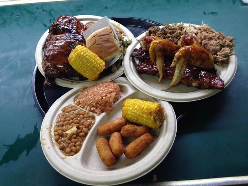 tray with three plates of BBQ