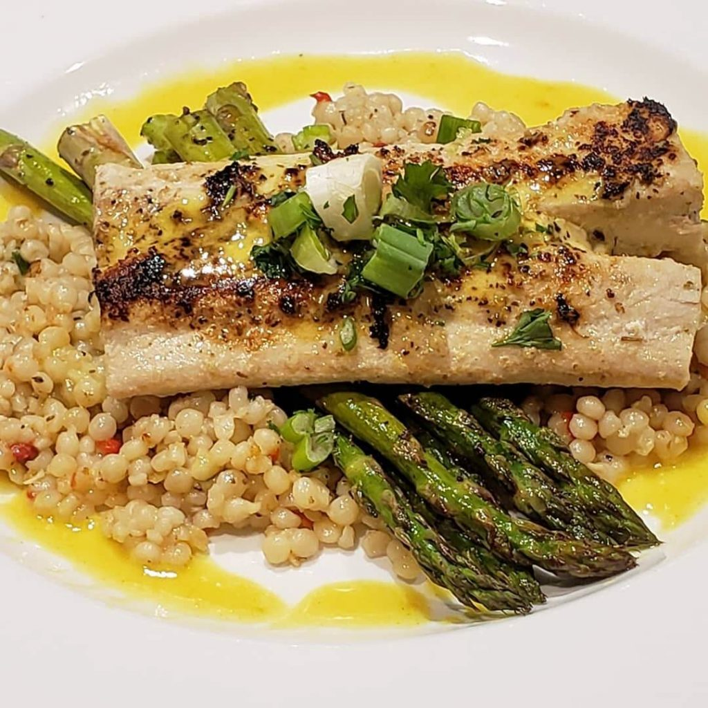 Greek roasted fish dish with asparagus