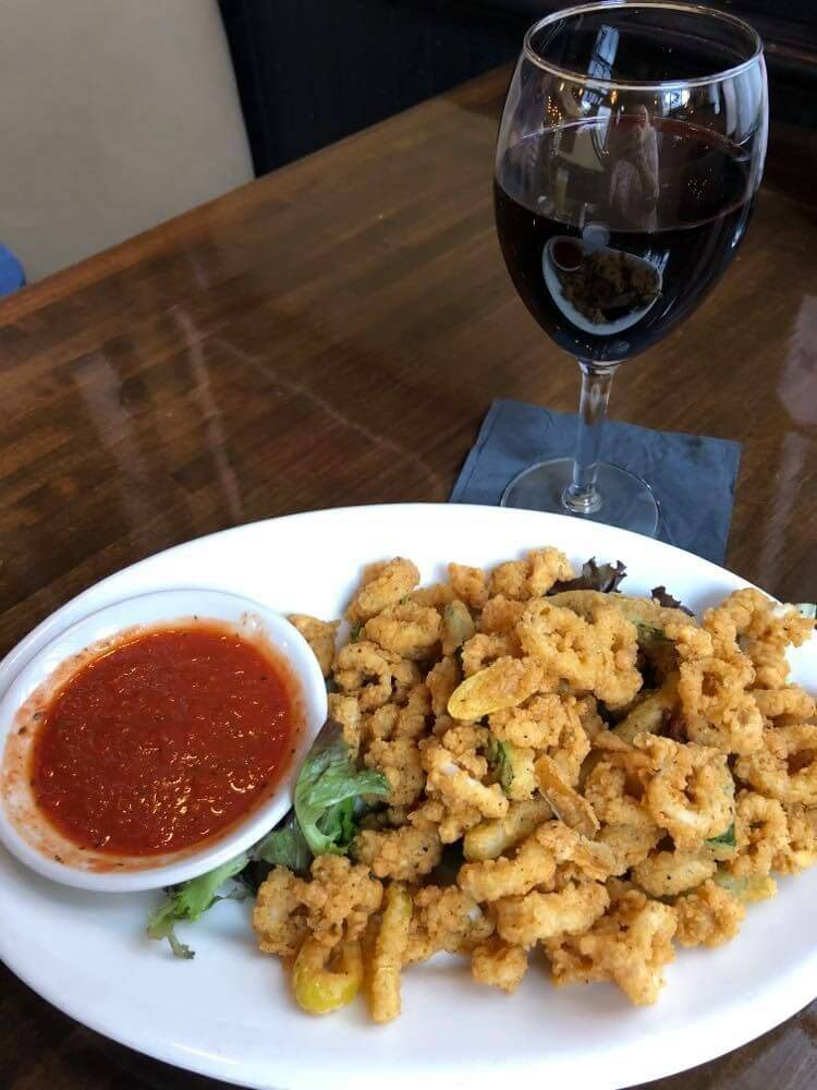 fried calamari, red sauce, glass of red wine