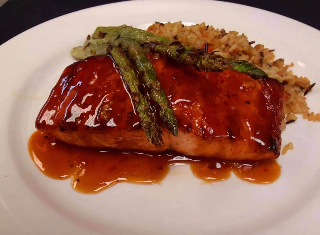 grilled salmon with sauce, roasted asparagus and rice