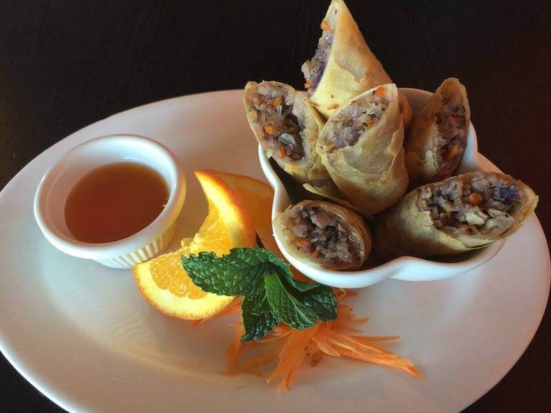 fried spring rolls with a dipping sauce