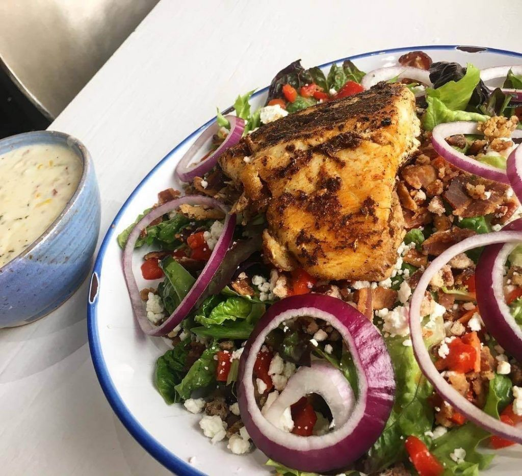 salad topped with grilled chicken