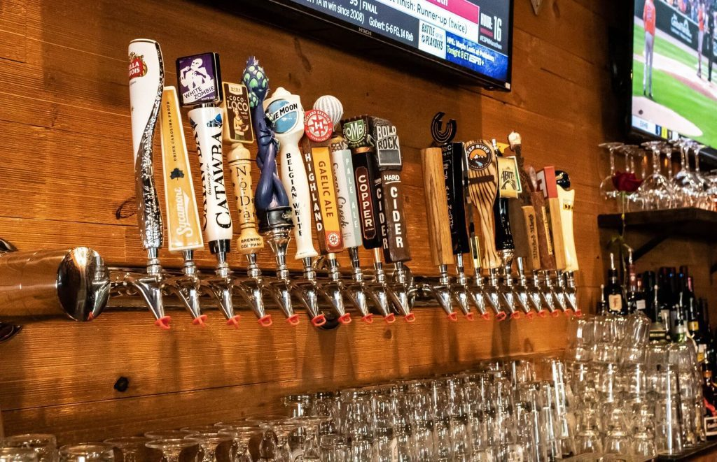 bar full of beers on tap