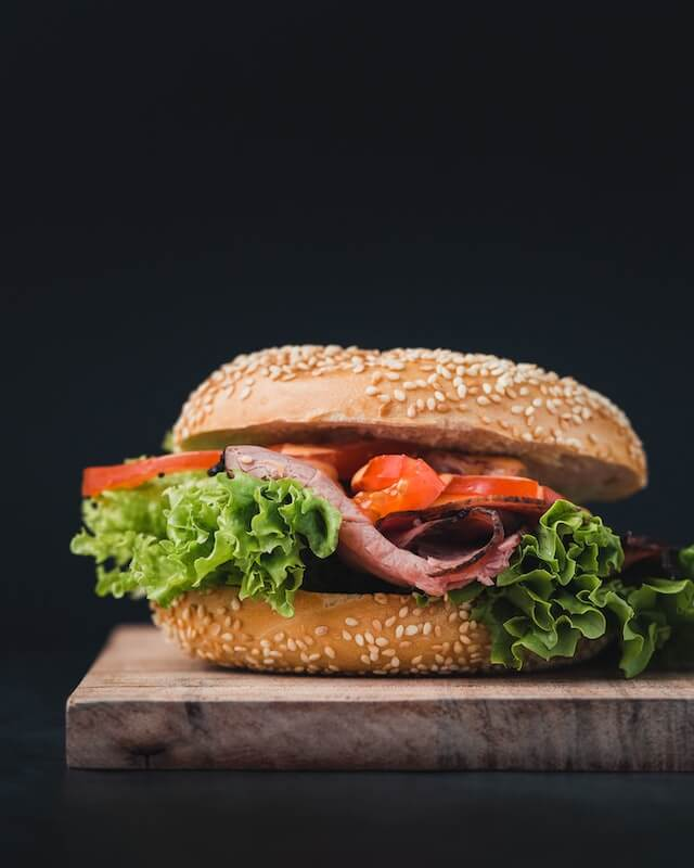 bagel sandwich with ham lettuce and tomato
