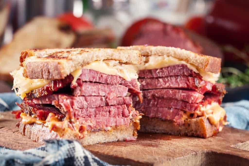 Reuben with sliced corn beef on rye with sauerkraut
