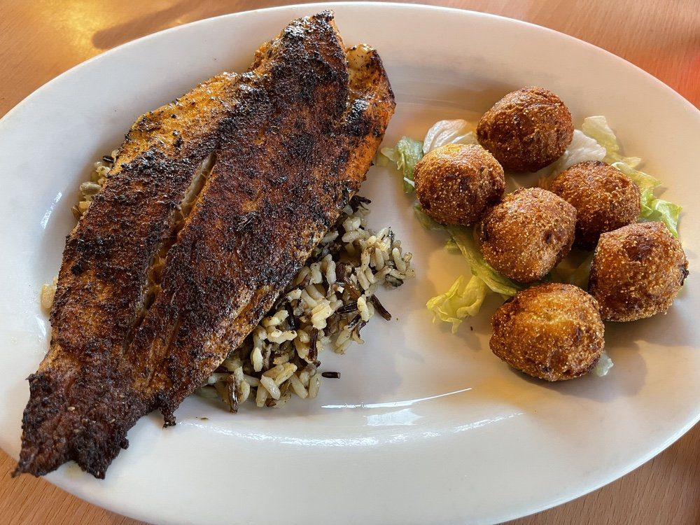 7 Must-Try Bay St. Louis Restaurants: Blackened Redfish and Hush Puppies