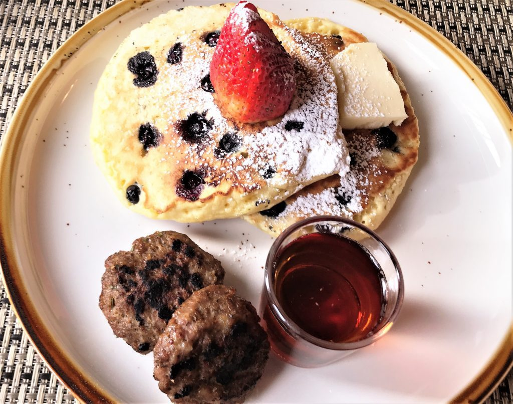 7 Best Restaurants in Ludington MI: Blueberry Pancakes with 21-Spice Sausage Patties